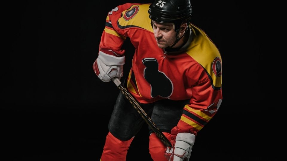 Holding Hockey Stick